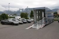 Luxury car transportation by truck